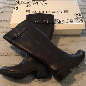Dark brown riding boots. Gold buckle.